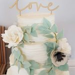 Four Tier Rustic Iced Wedding cake with Floral Wreath by White Rose Cake Design, Wedding Cakes in West Yorkshire