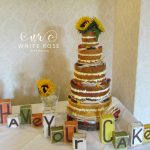 Naked Wedding Cake with Sunflowers by White Rose Cake Design, Wedding Cakes in West Yorkshire