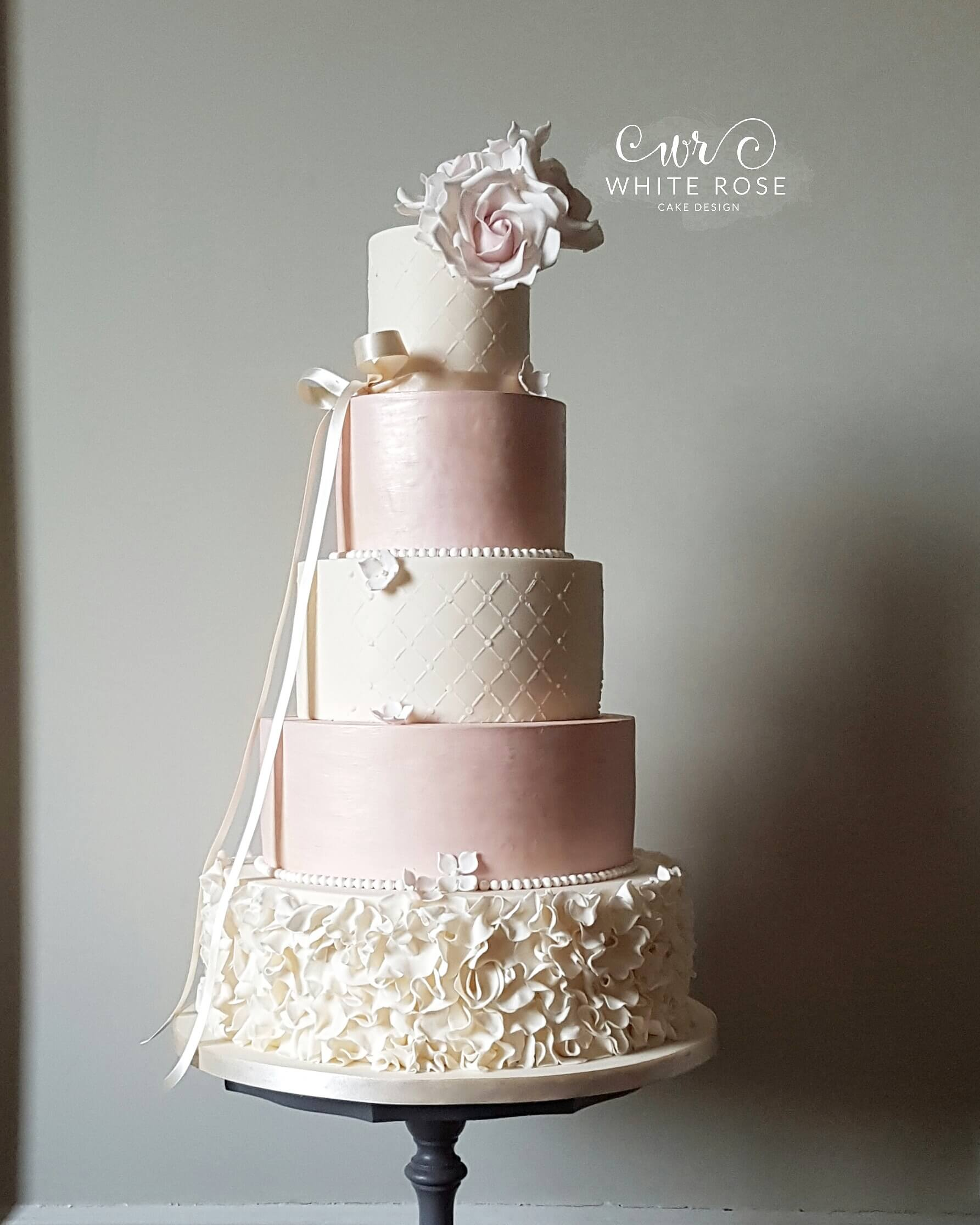 Five Tier Pink And Ivory Ruffles Wedding Cake With Blush Roses By