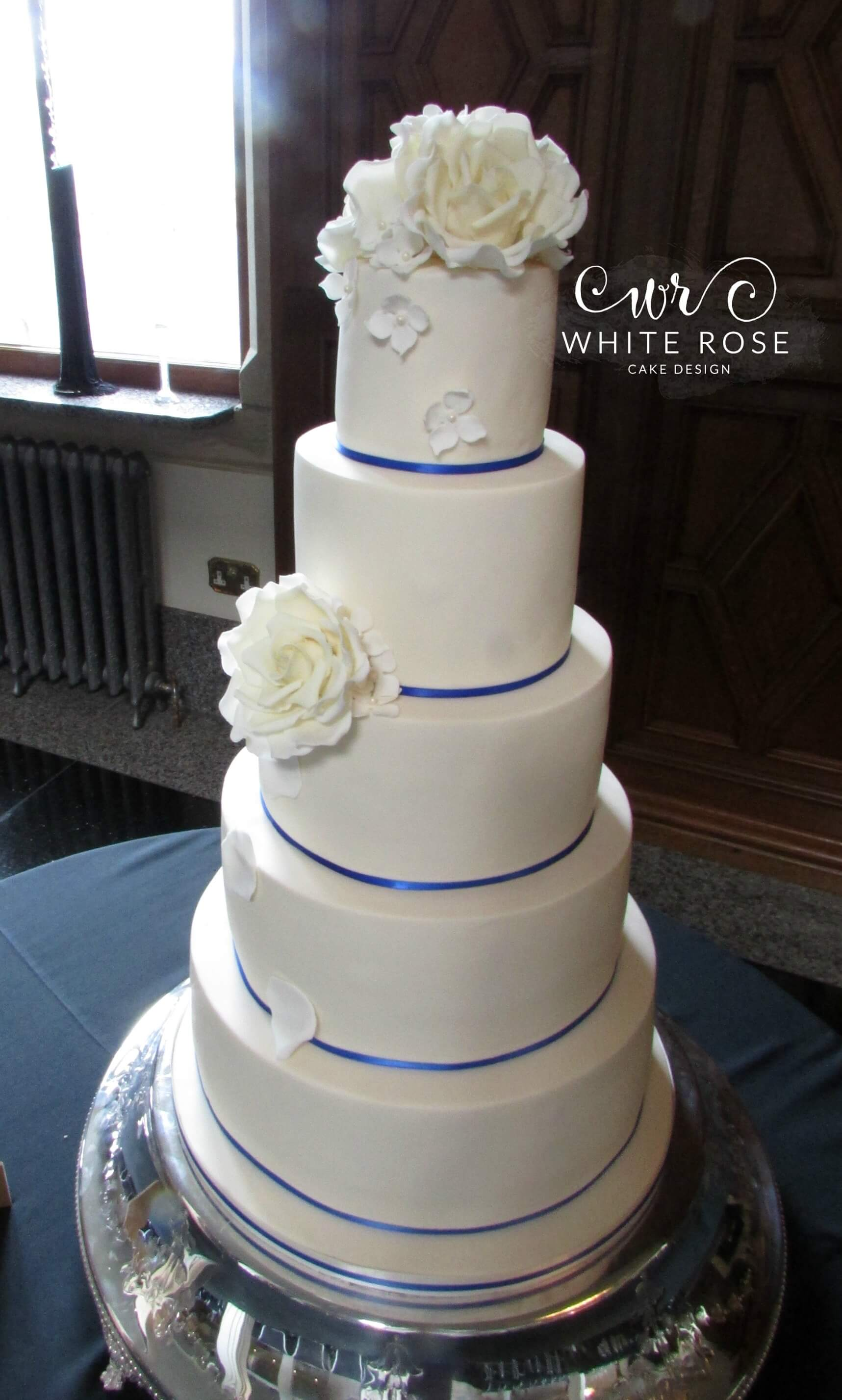 Ivory and Royal Blue Wedding Cake by White Rose Cake Design, Wedding Cakes in West Yorkshire