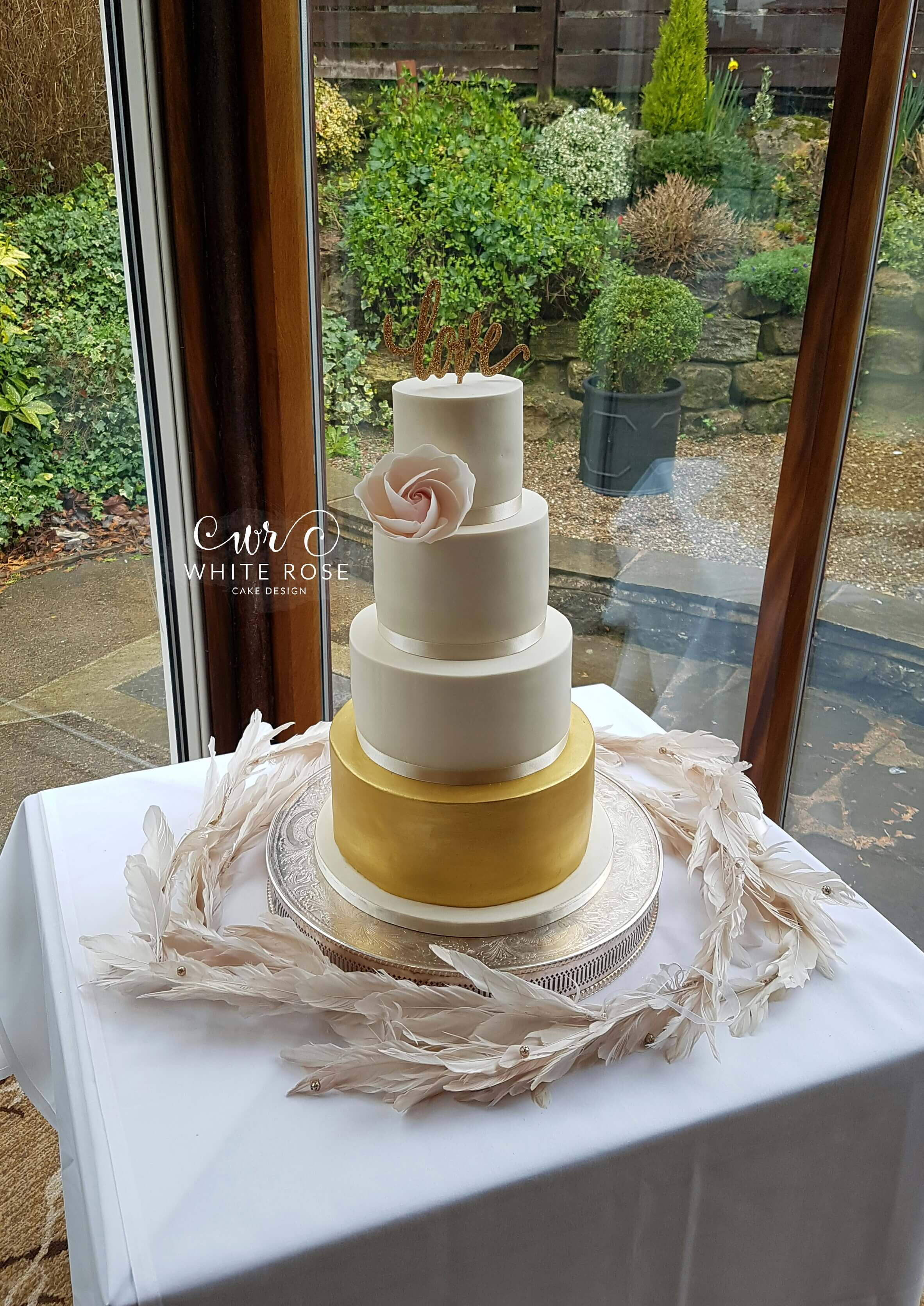 Four Tier Ivory Blush and Gold Wedding Cake with Statement Rose by White Rose Cake Design, Wedding Cakes in West Yorkshire