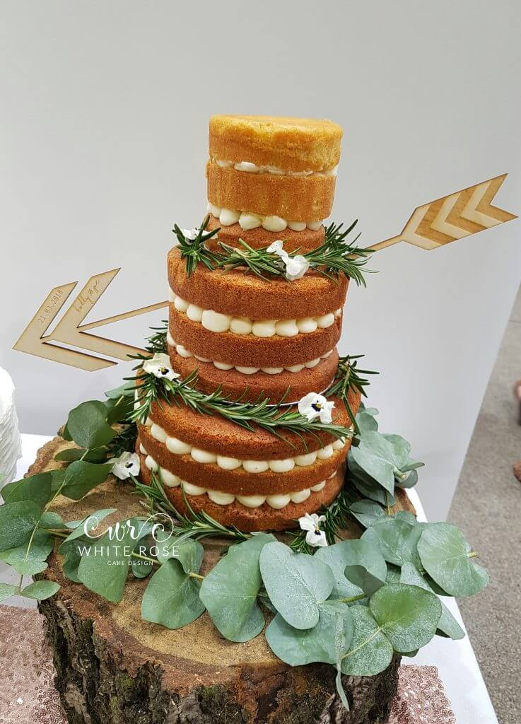 Three Tier Rustic Naked Wedding Cake with Greenery Foliage Tree Stump Stand and Arrow Through by White Rose Cake Design West Yorkshire Wedding Cake Maker in Holmfirth (2)