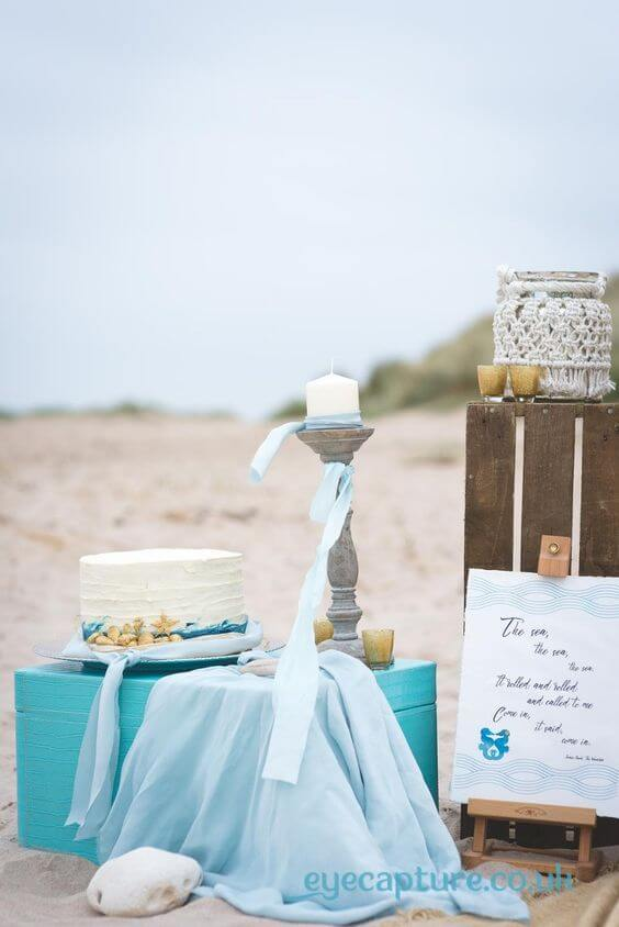 Beach Wedding Elopement Cake with Gold Seahorses and Shells, Blue Ombre and Raffia by White Rose Cake Design, Bespoke Wedding Cake Makers in West Yorkshire