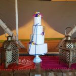 Boho Weddings Four Tier Wedding Cake with Gold Leaf, Edible Flowers and Royal Blue Ribbon in a Tipi by White Rose Cake Design Bespoke Wedding Cake Makers in Holmfirth Huddersfield West Yorkshire