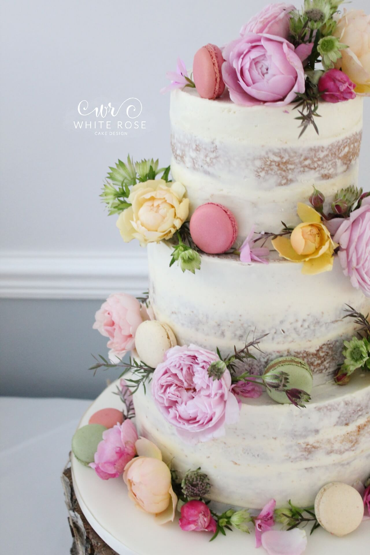 Floral Semi-Naked Wedding Cake with Fresh Flowers in Bright Colours ...
