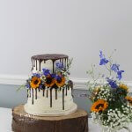 Two Tier Drippy Wedding Cake with Sunflowers and Country Flowers at Durker Roods by White Rose Cake Design Wedding Cakes in West Yorkshire (2)