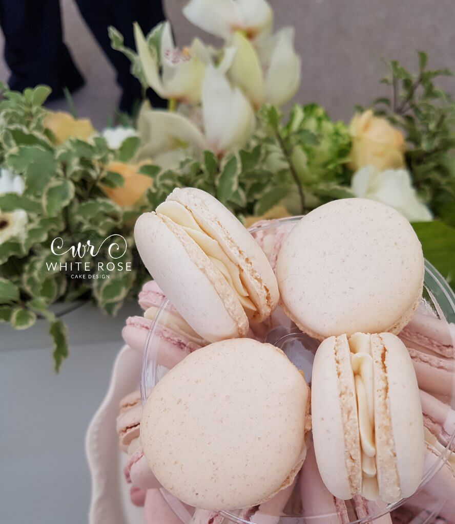 Natural macarons with greenery wedding cakes at Woodsome Hall Golf Club
