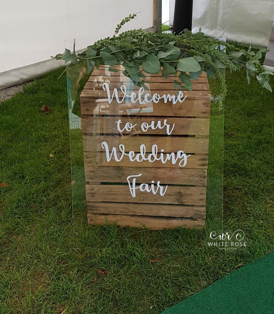 Perspex clear wedding welcome sign wedding cakes at Woodsome Hall Golf Club