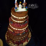 3 Tier Naked Wedding Cake with Quirky Lego Topper White Rose Cake Design Cake Maker in West Yorkshire