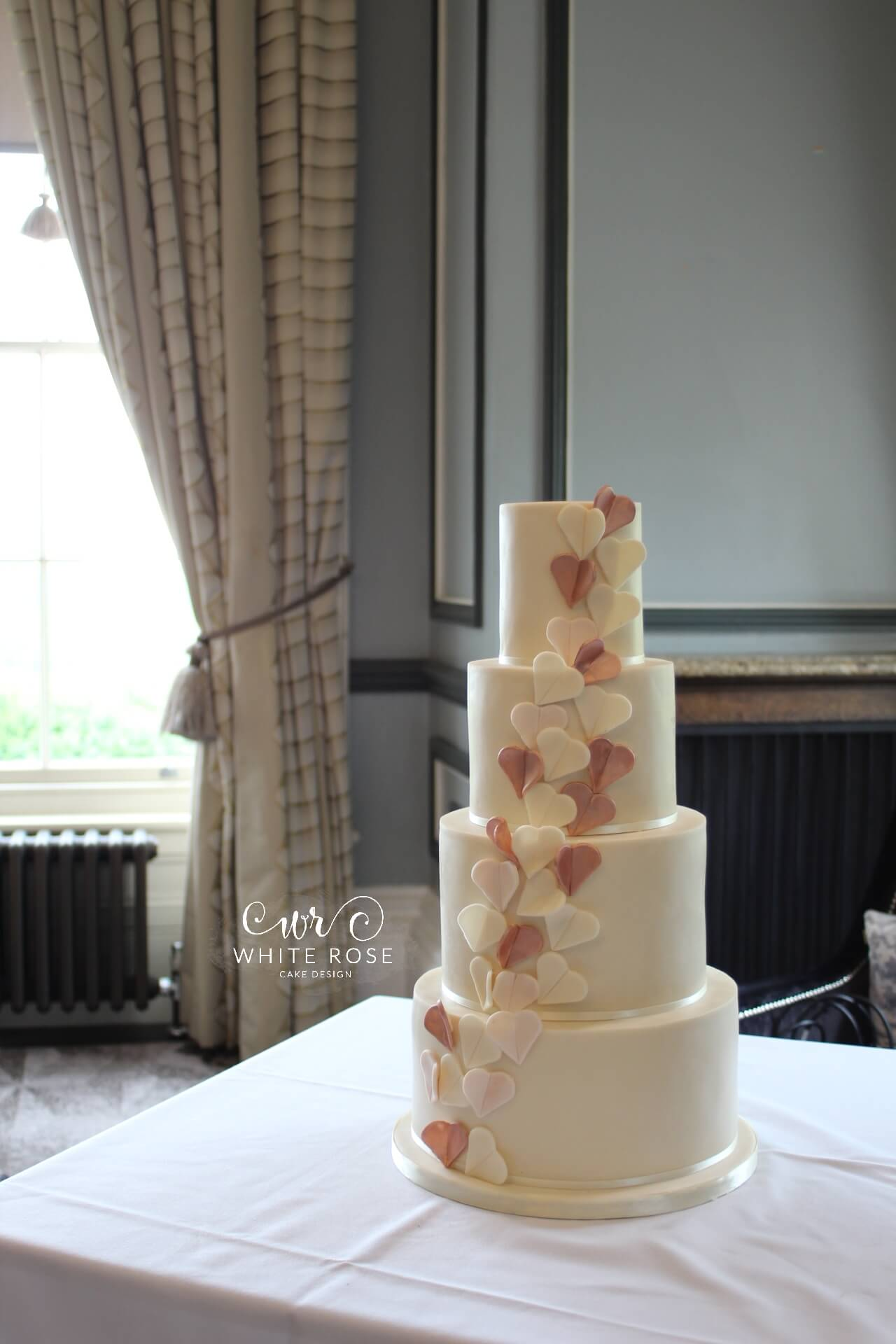 Rose Gold Folded Hearts Wedding Cake by White Rose Cake Design at Oulton Hall West Yorkshire