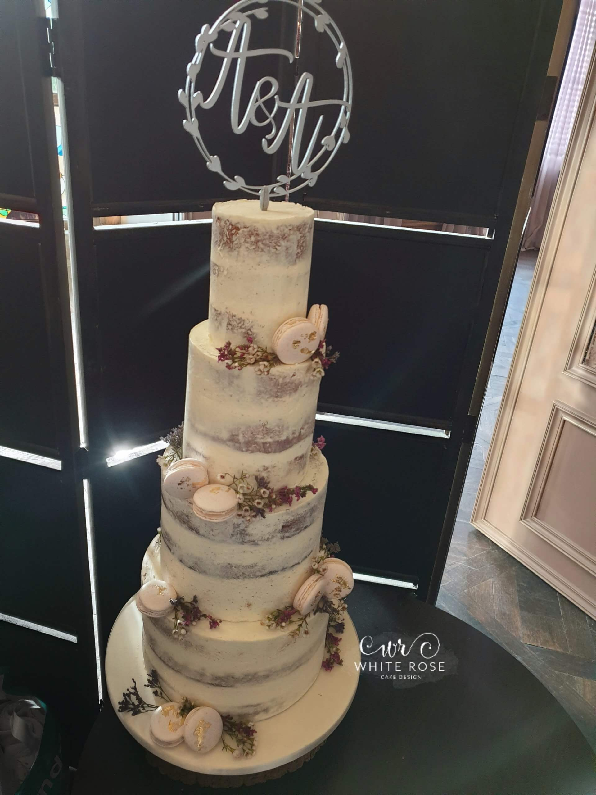 Semi-Naked Wedding Cake with Dried Flowers and Pink Macarons at Manor House Lindley by White Rose Cake Design in Holmfirth (3)