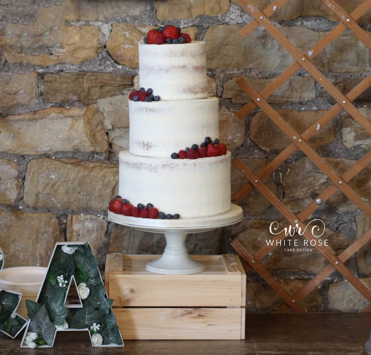 Semi-Naked Wedding Cake with Fresh Berries at Oakwell Hall by White Rose Cake Design Bespoke Cake Makers in West Yorkshire