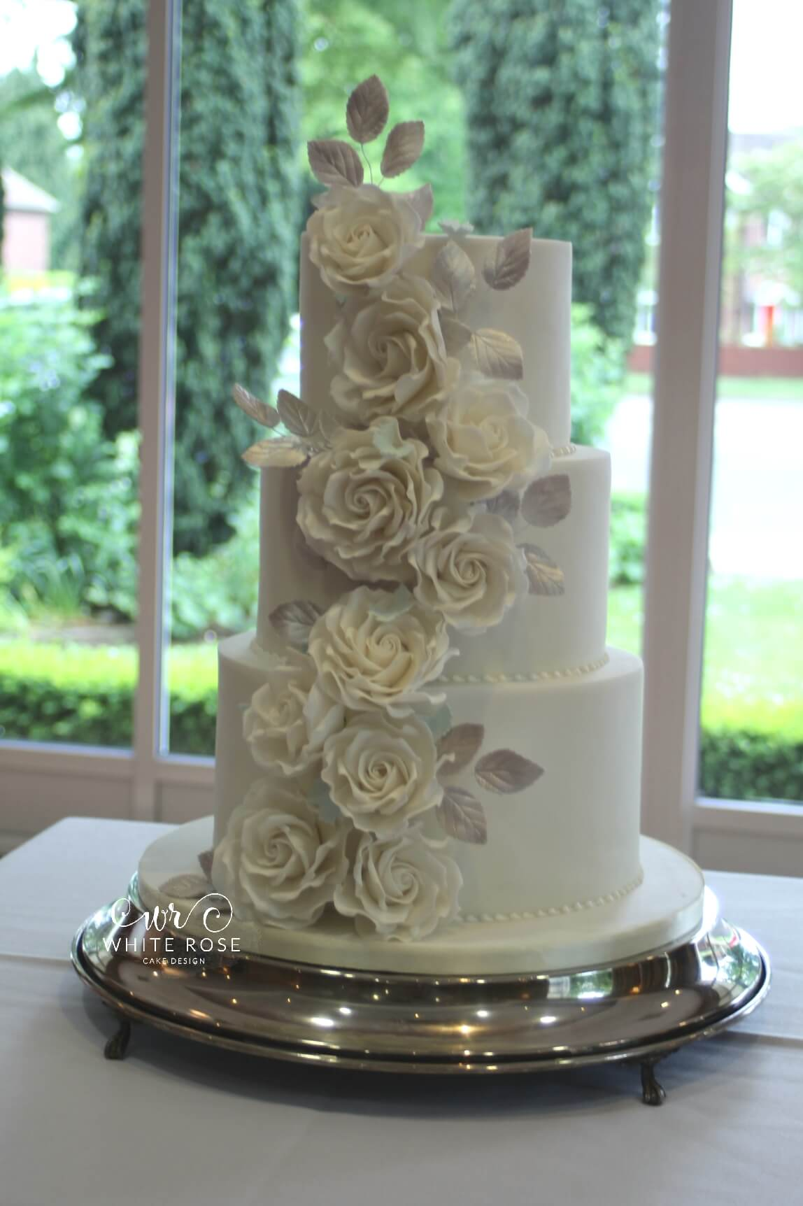 Three Tier White Rose Cascade Wedding Cake by White Rose Cake Design West Yorkshire Cake Maker