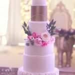 6 Tier wedding cake with floral hoop wreath and ruffles by White Rose Cake Design