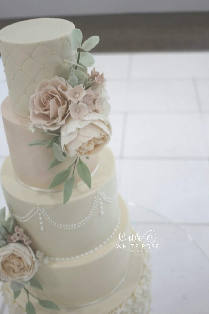Pale Feminine Wedding Cake with Flowers - Elegant Five Tier Wedding Cake with Peach & Nude Flowers by White Rose Cake Design Luxury Cakes West Yorkshire