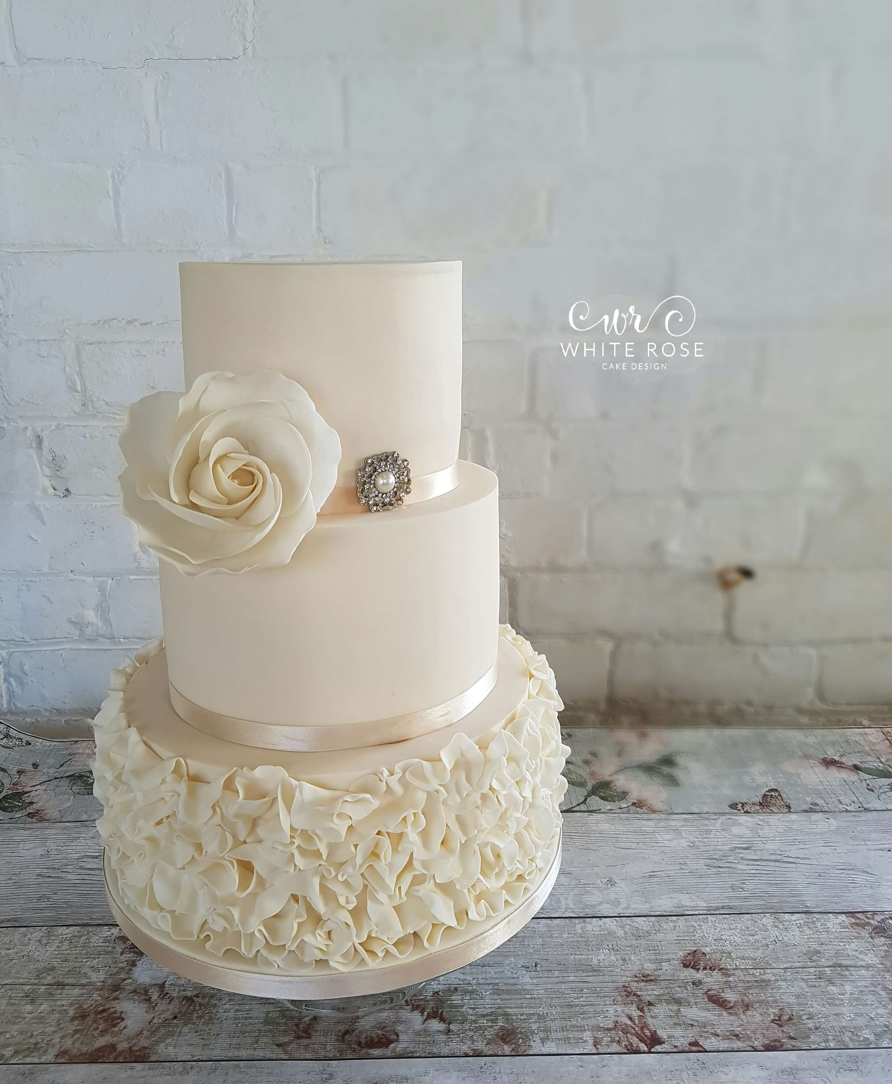 why is wedding cake tiered 3 tier wedding cake with ivory ruffles and whimsical 27472