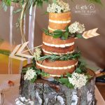 Three Tier Naked Wedding Cake with Elder Flowers and Foliage White Rose Cake Design Bespoke Wedding Cake Maker in Holmfirth Huddersfield West Yorkshire