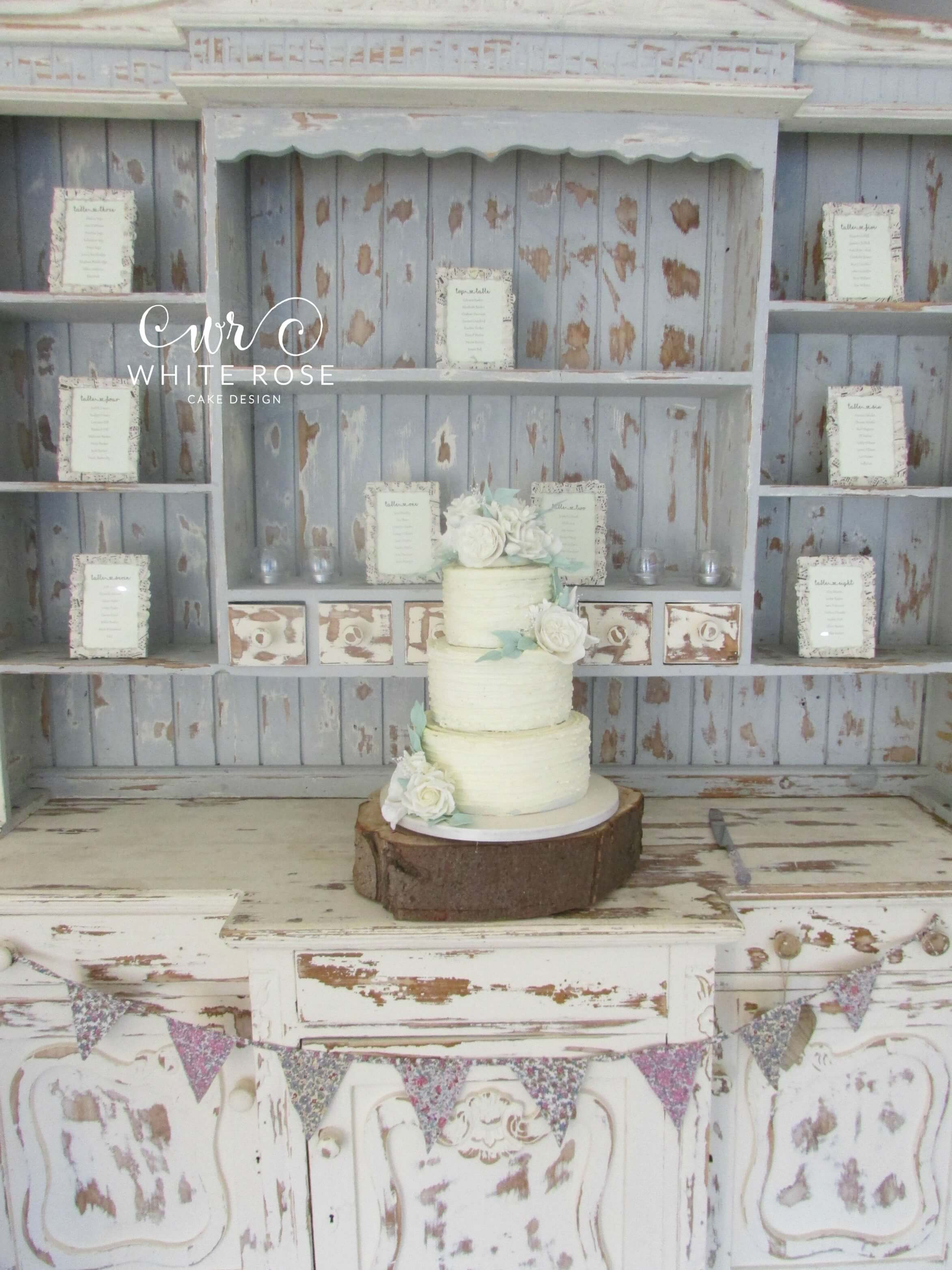 Three Tier Rustic Buttercream Wedding Cake with White and Ivory Sugar Flowers West Yorkshire Cake Maker