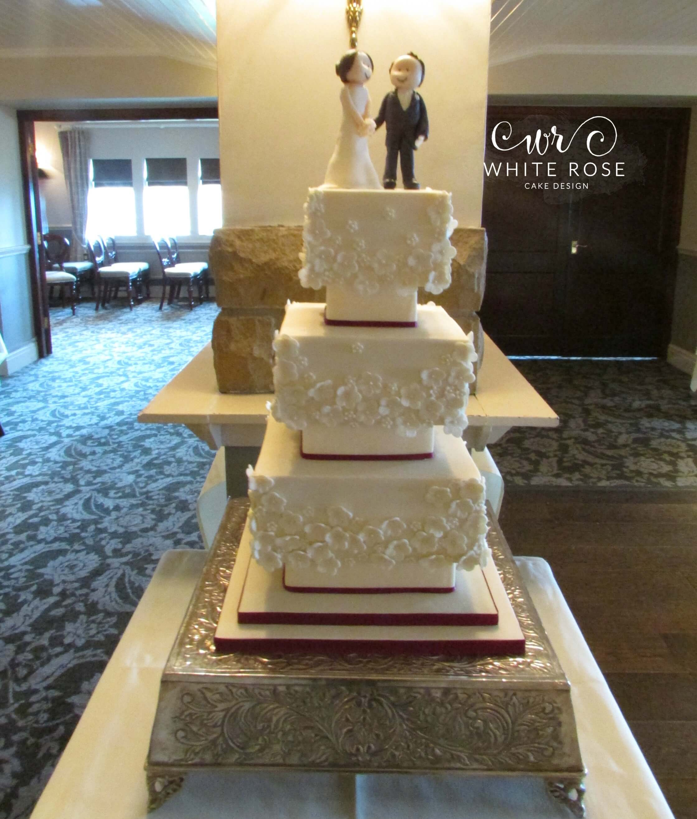 why is wedding cake tiered three tier square blossoms wedding cake huddersfield cake 27472