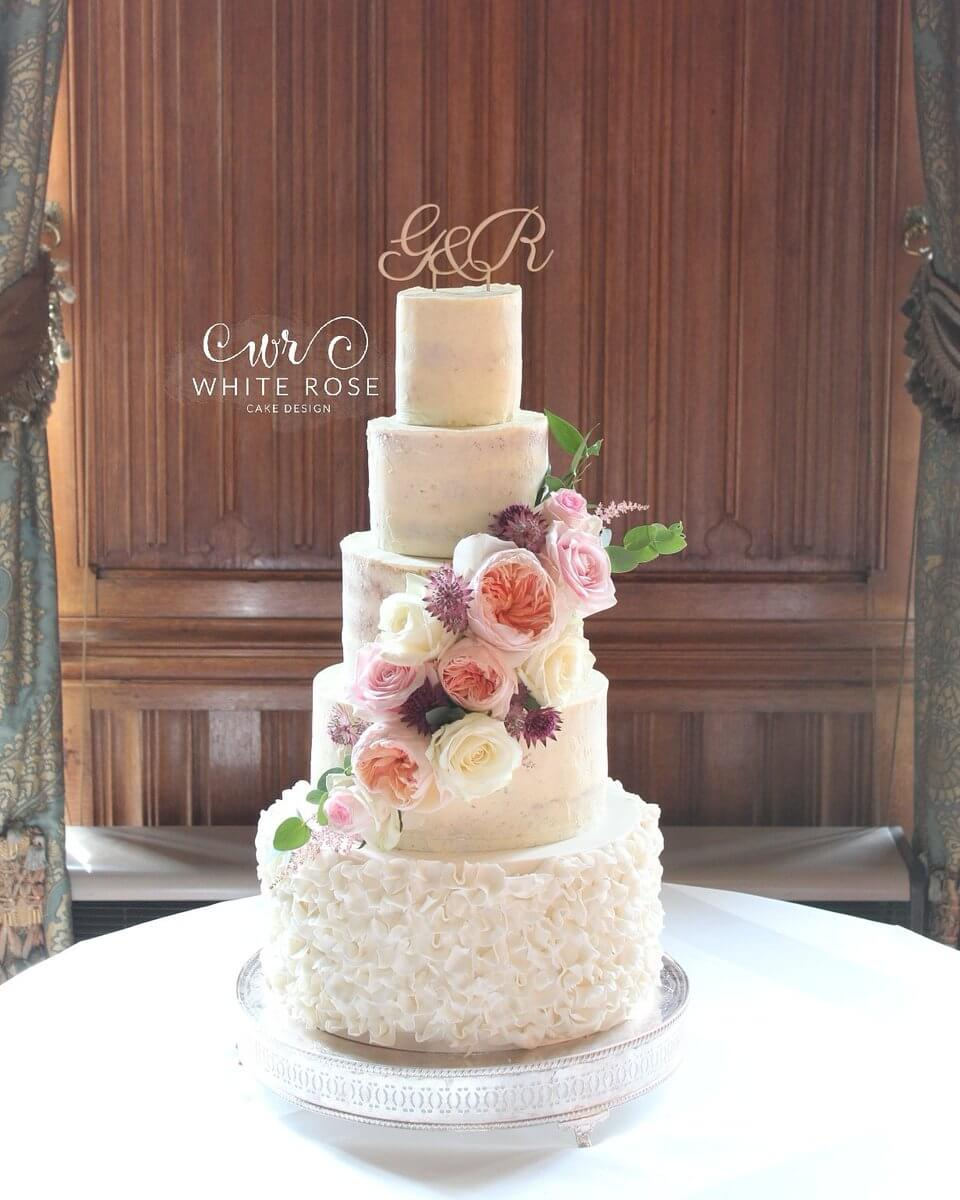 Five Tier Semi Naked Wedding Cake with Fresh Roses and Ruffles