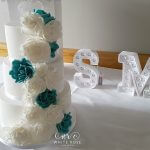 Three-Tier-Teal-and-Ivory-Roses-Cascade-Wedding-Cake-by-White-Rose-Cake-Design-Wedding-Cake-Maker-in-West-Yorkshire