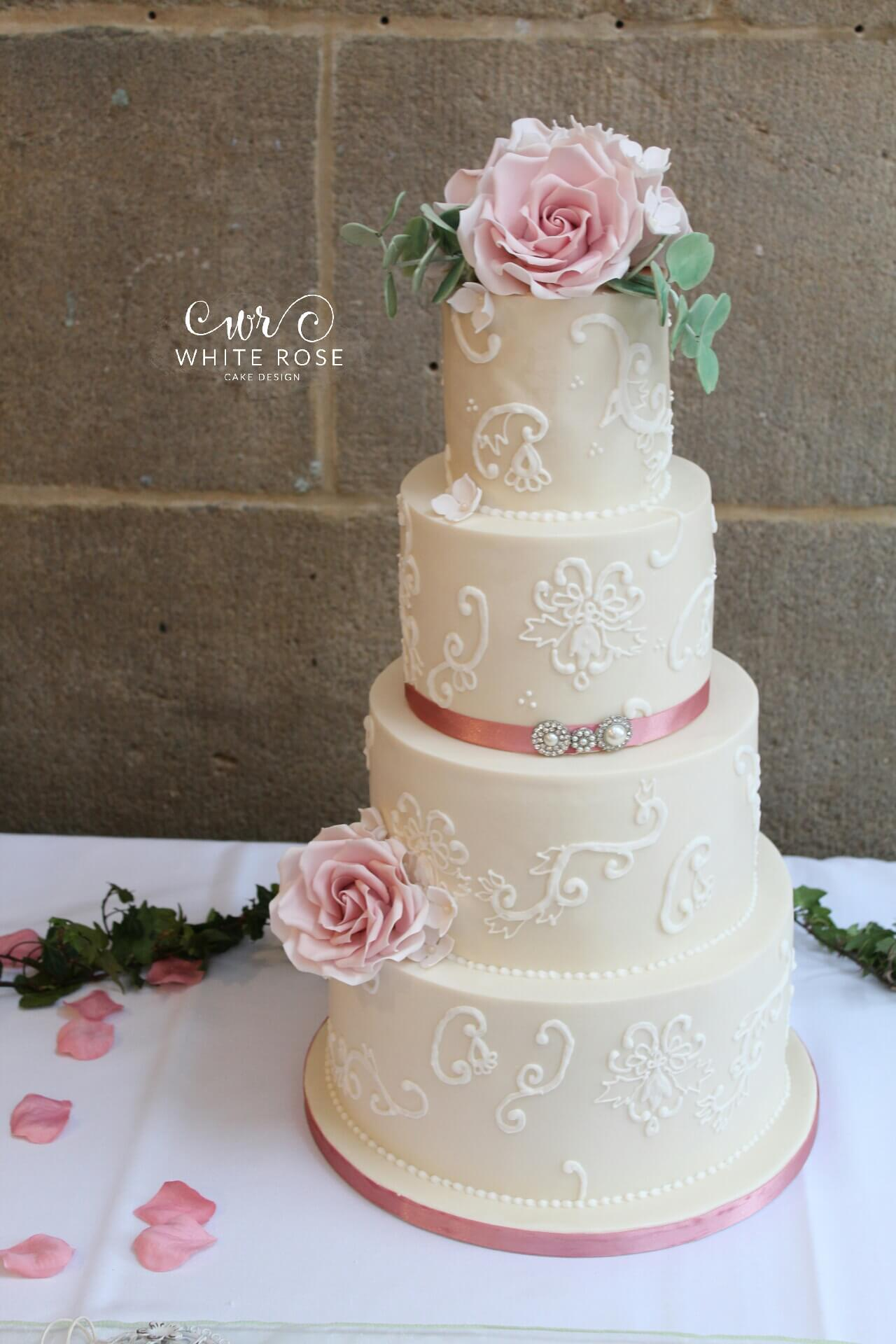 white wedding cake with black roses modern luxurious wedding cakes in holmfirth west 27401