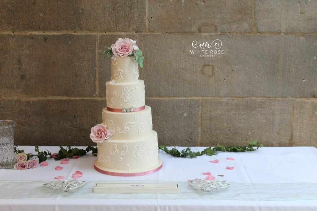4 Tier Vintage Lace Wedding Cake with Dusky Pink Roses by White Rose Cake Design Wedding Cakes in Holmfirth, West Yorkshire, Leeds