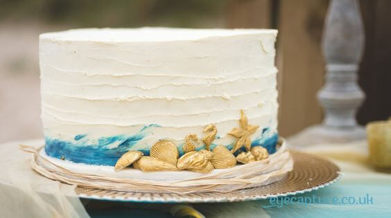 Beach Elopement Wedding Cake with Gold Seahorses and Shells, Blue Ombre and Raffia by White Rose Cake Design, Bespoke Wedding Cake Makers in West Yorkshire