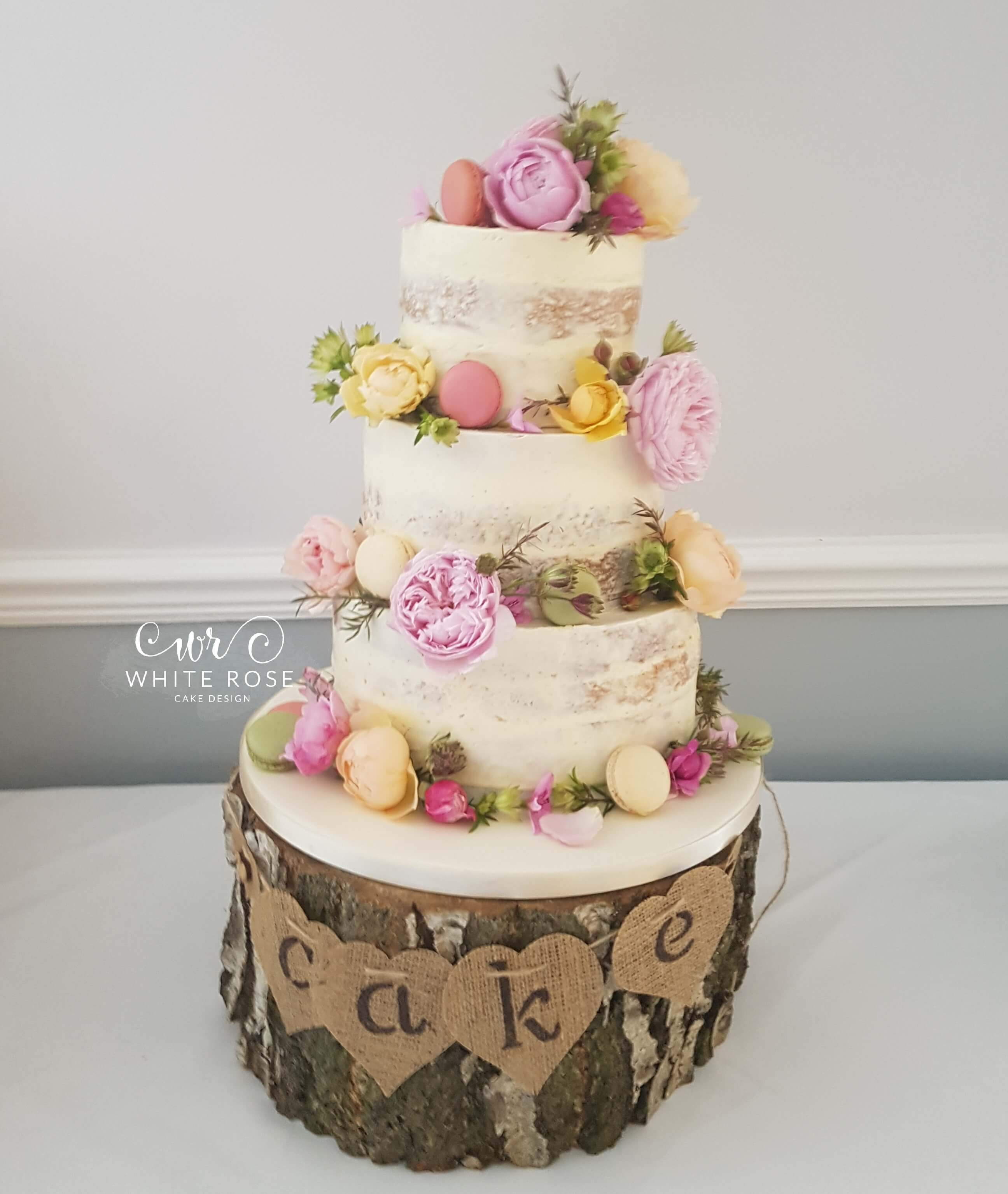 Floral Semi Naked Wedding Cake With Fresh Flowers In Bright Colours At Durker Roods Hotel