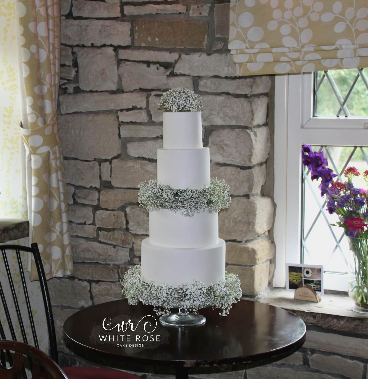 Four Tier Wedding Cake with Gypsophelia at The Sands House in Huddersfield by White Rose Cake Design Wedding Cake Makers