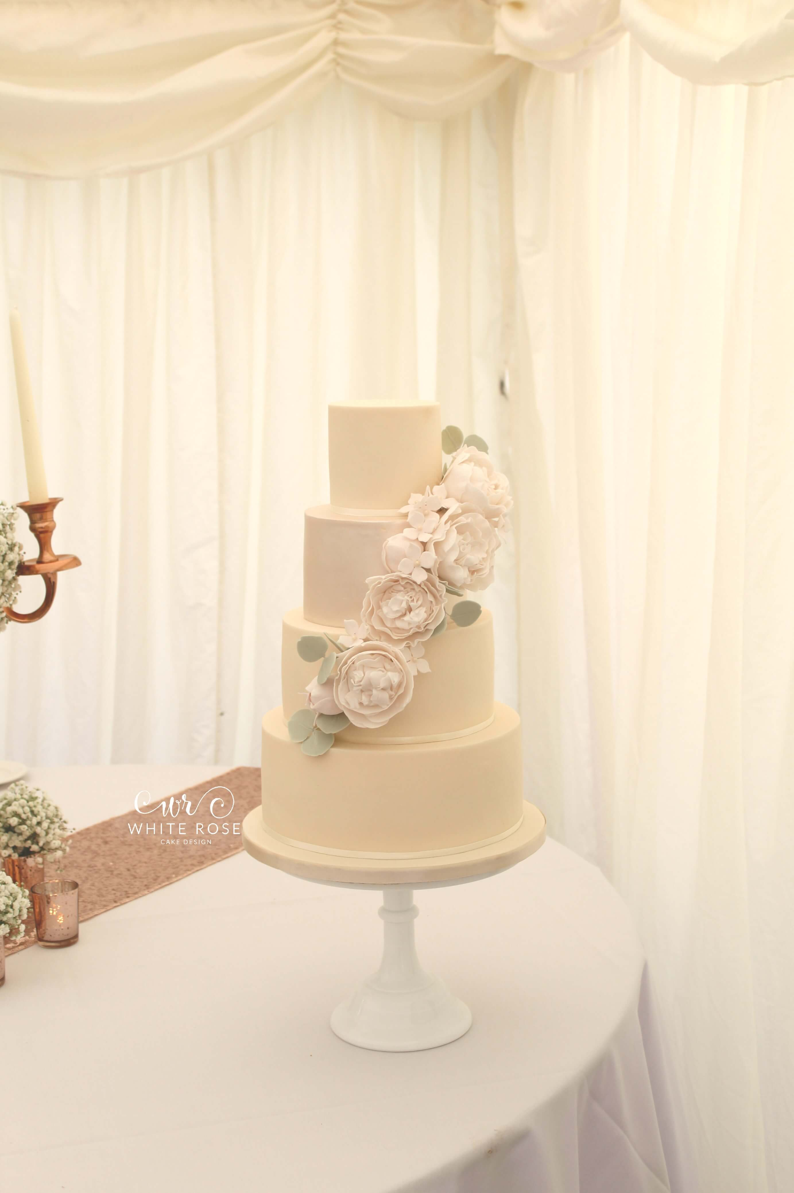 Four Tier White on White Wedding Cake with Lustre and Peonies by White Rose Cake Design in West Yorkshire