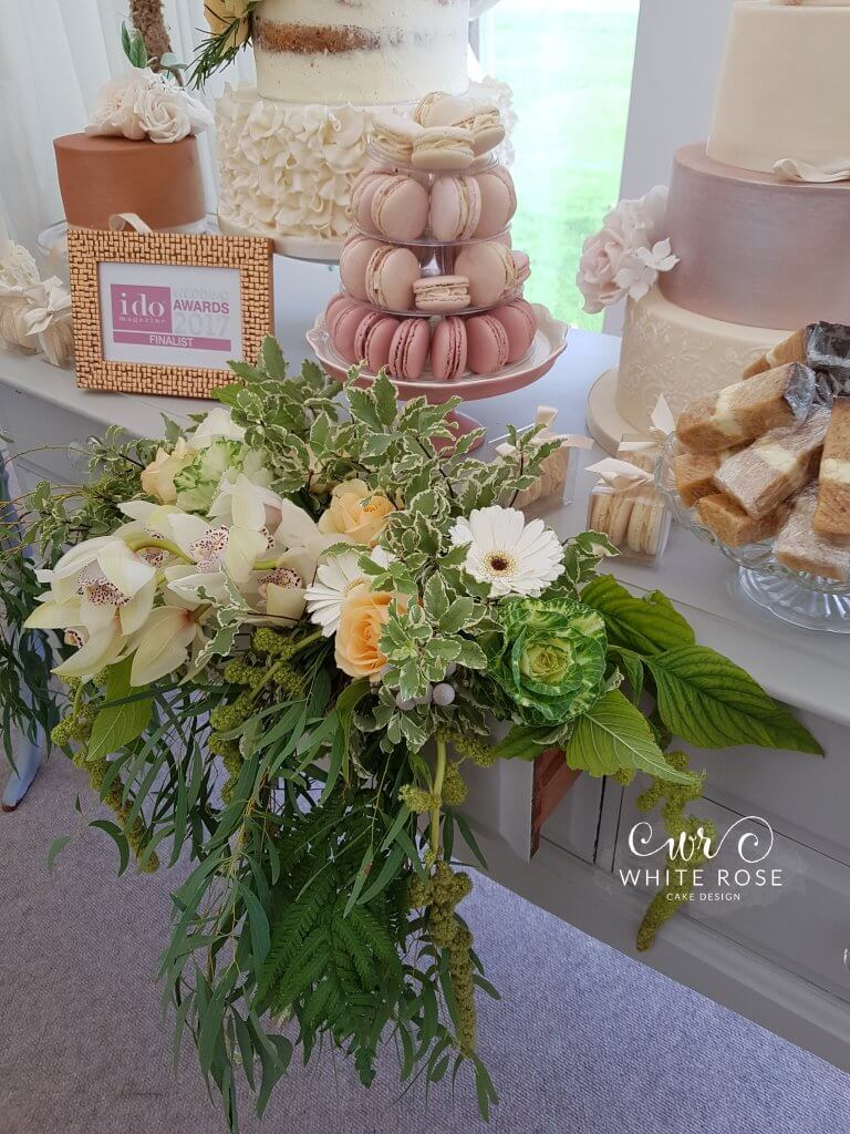 Beautiful greenery display by Woo B Woo White Rose Cake Design wedding cakes at Woodsome Hall Golf Club