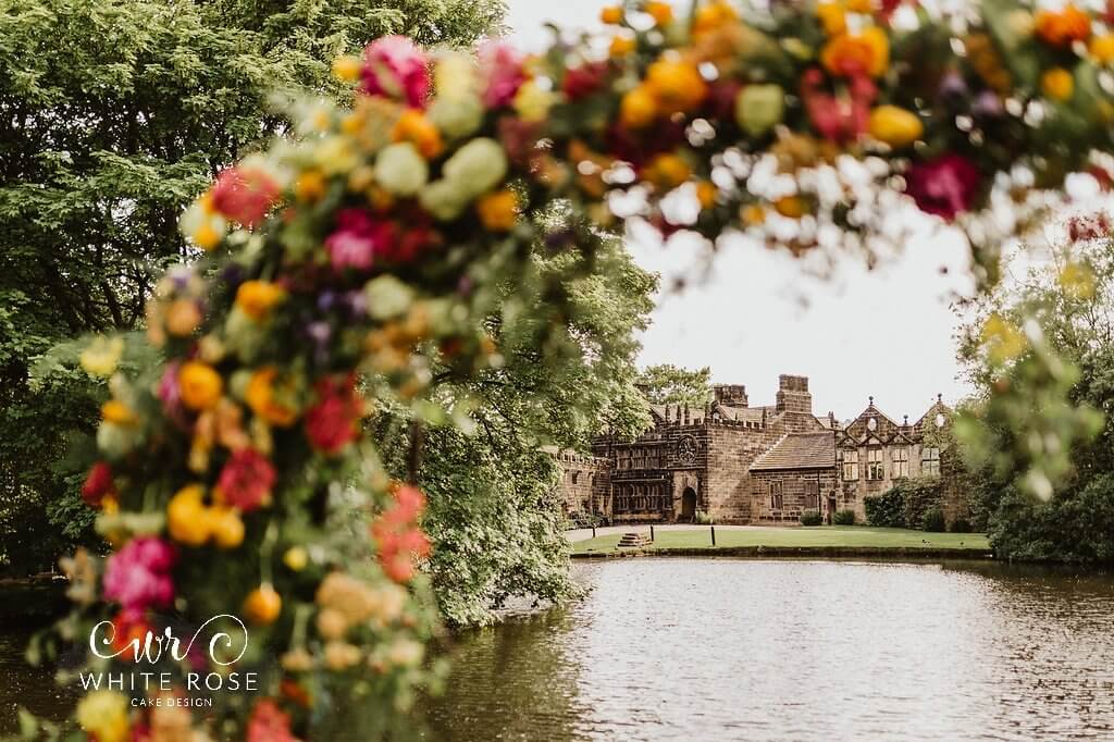 Floral Arch East Riddlesden Hall Wedding Cakes Photo by Caitlin + Jones Cake by White Rose Cake Design Stems Design Wedding Flowers (2)
