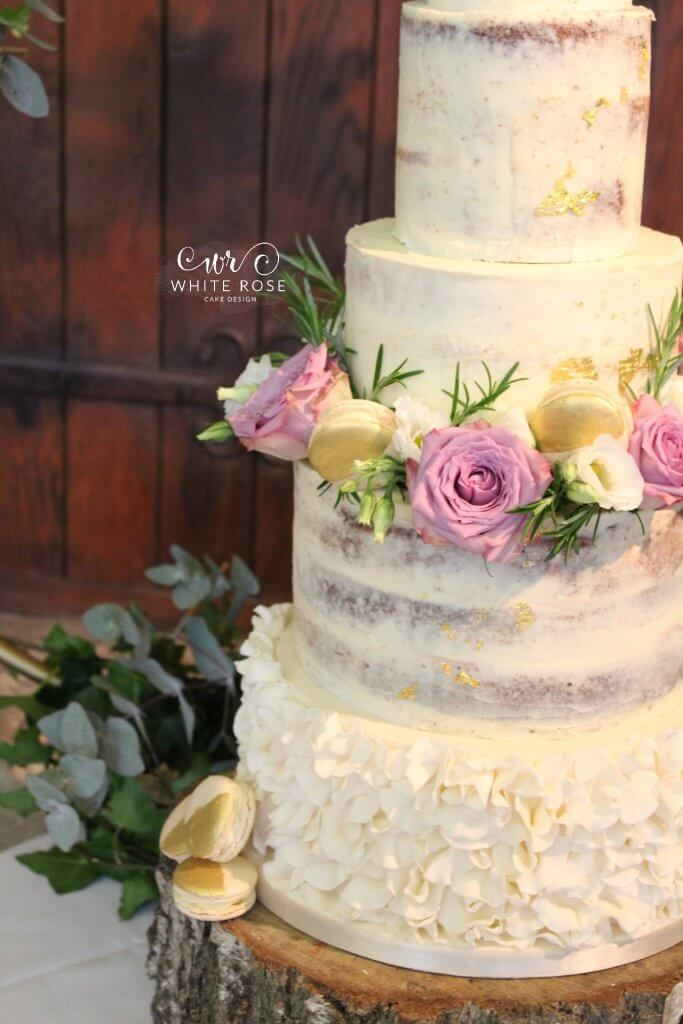 Five Tier Semi Wedding Cake With Ruffles Macarons And Fresh Mauve Flowers At