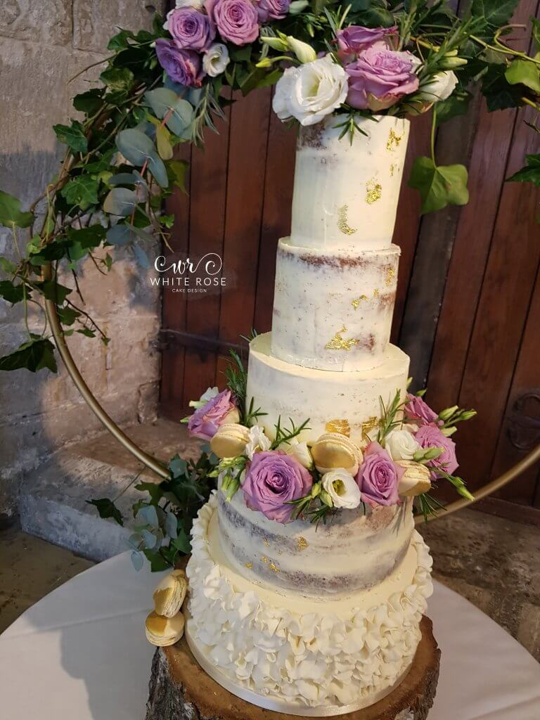 Five Tier Semi-Naked Wedding Cake with Ruffles, Macarons and Fresh Mauve Flowers at Hazelwood Castle by White Rose Cake Design Wedding Cakes in West Yorkshire
