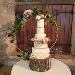 Five Tier Semi-Naked Wedding Cake with Ruffles, Macarons and Fresh Mauve Flowers at Hazelwood Castle by White Rose Cake Design Wedding Cakes in West Yorkshire (4)