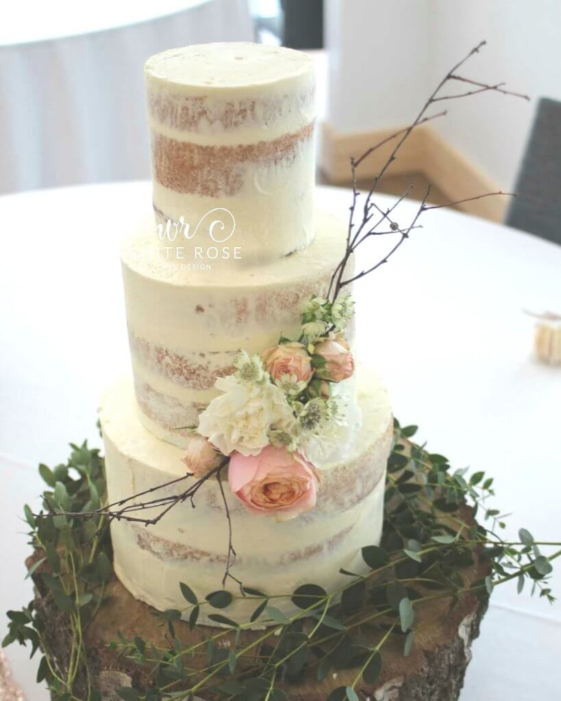 Semi-Naked Wedding Cake with Rustic Fresh Flowers by White Rose Cake Design West Yorkshire