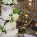 Semi-Naked Wedding Cake with Greens and Whites Fresh Flowers White Rose Cake Design