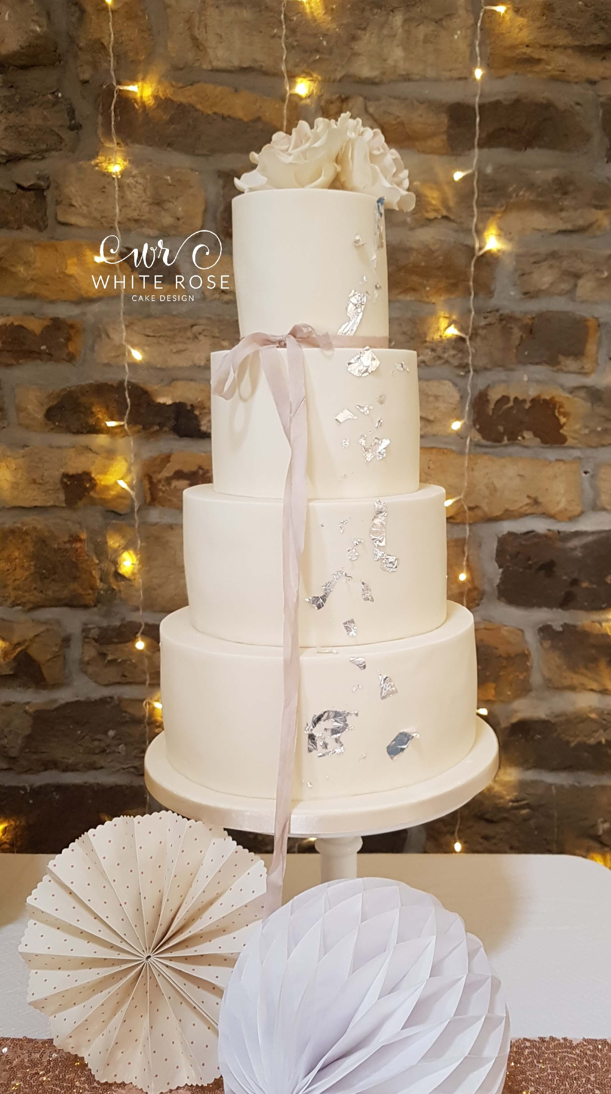 Simple Four Tier Wedding Cake with Silk Ribbon and Silver Leaf White Rose Cake Design