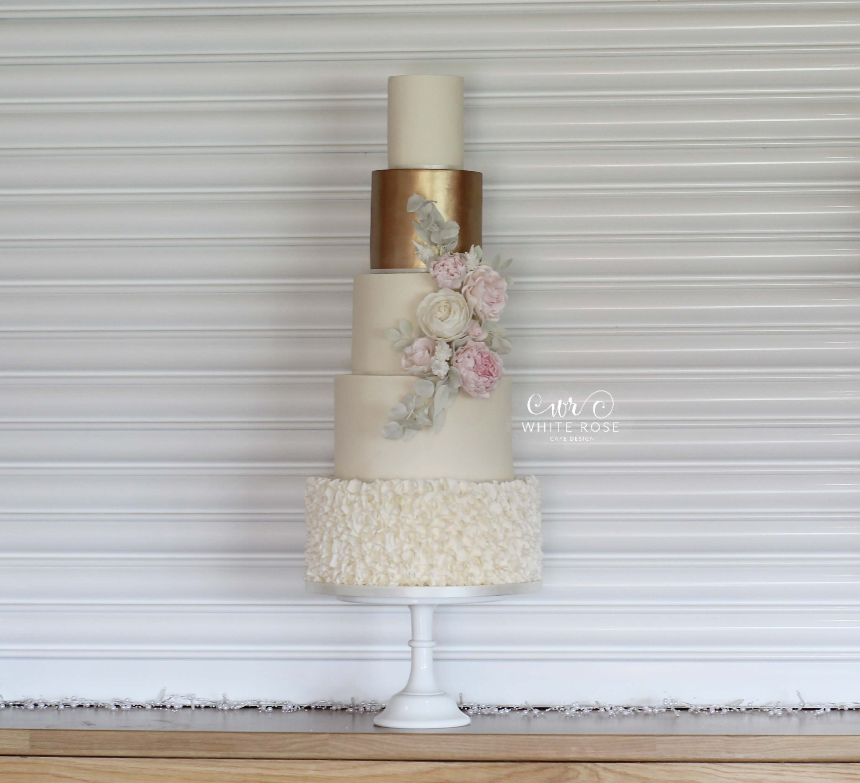 Five Tier Elegant Wedding Cake – Ivory and Copper with Blush Flowers by White Rose Cake Design Bespoke Wedding Cakes in West Yorkshire
