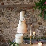 Five Tier Peach Watercolour Torn Paper Wrap Wedding Cake with Semi-Naked Tier by White Rose Cake Design West Yorkshire