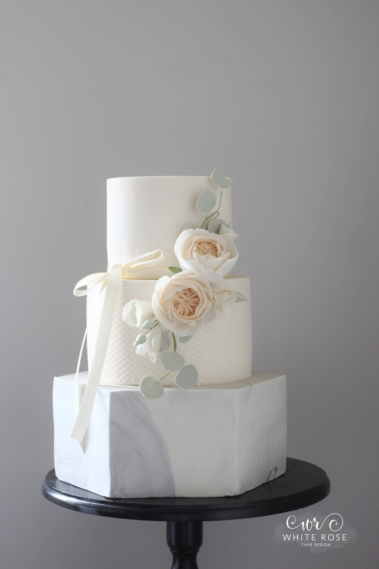 Peach roses and marble hexagon tier wedding cake by White Rose Cake Design Cake maker in Yorkshire