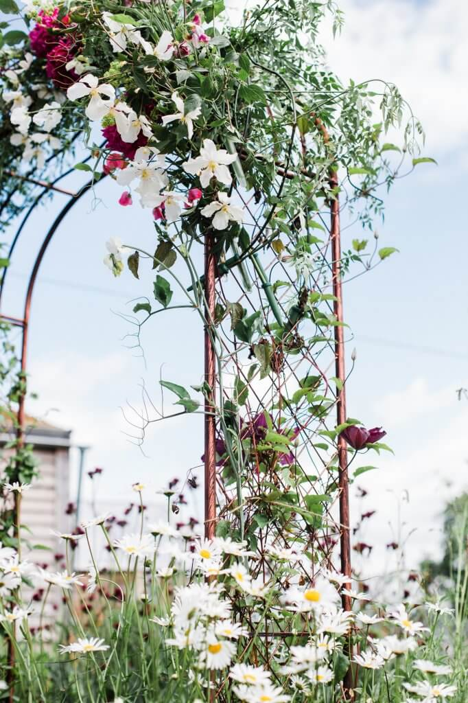 Floral Arch - Colourful Rustic DIY Wedding in Huddersfield - White Rose Cake Design Luxury Wedding Cakes