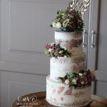 Semi naked wedding cake with fresh flowers and rose gold by White Rose Cake Design Cake maker in Huddersfield