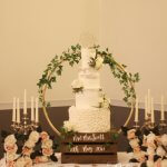 Four Tier Semi-Naked Wedding Cake with Ruffles White and Green by White Rose Cake Design at Tankersley Manor Hotel