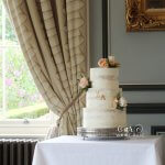 Three Tier Semi-Naked Wedding Cake with Peach Roses by White Rose Cake Design at Oulton Hall