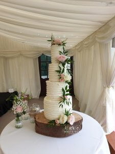 4-Tier-Rustic-Buttercream-Wedding-Cake-with-Pink-Flowers-Modern-Wedding-Cake-by-White-Rose-Cake-Design-Luxury-Wedding-Cakes-in-West-Yorkshire