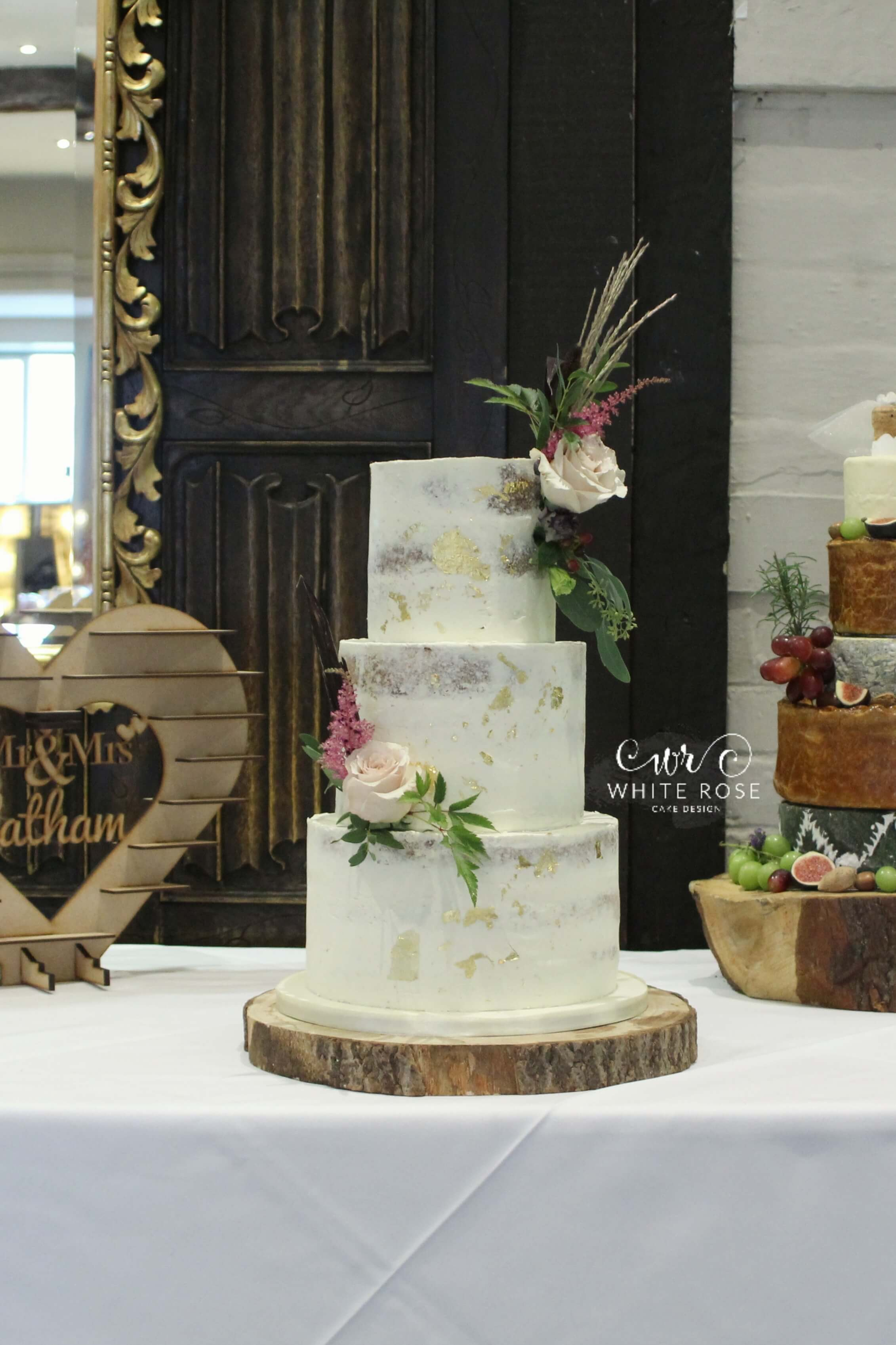 Semi-Naked Wedding Cake by White Rose Cake Design at Holdsworth House